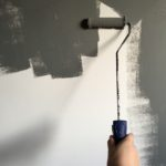 person-holding-paint-roller-while-painting-the-wall-994164 (1)